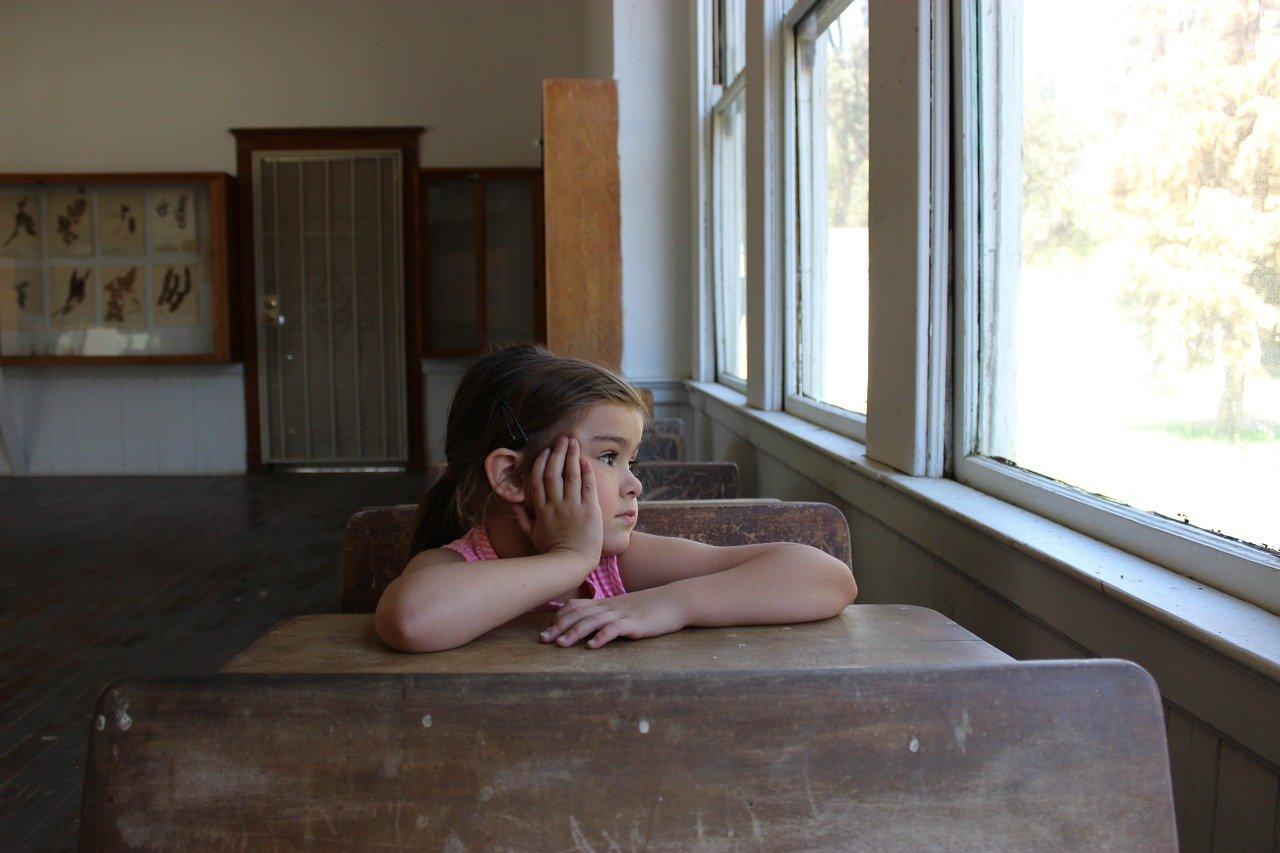 Child sitting at school desk